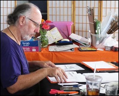 Volunteer Steve Lamb assembles precinct packets at Sunrise Center (10-15-2015). CWSM staff photo.